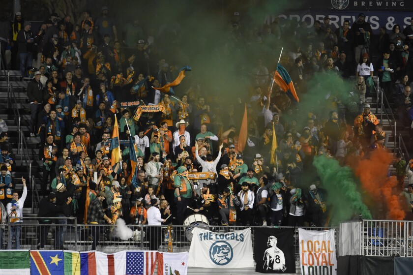 San Diego Loyal fans cheer after the Loyal scored a goal against the Las Vegas Lights on March 7 at USD's Torero Stadium.