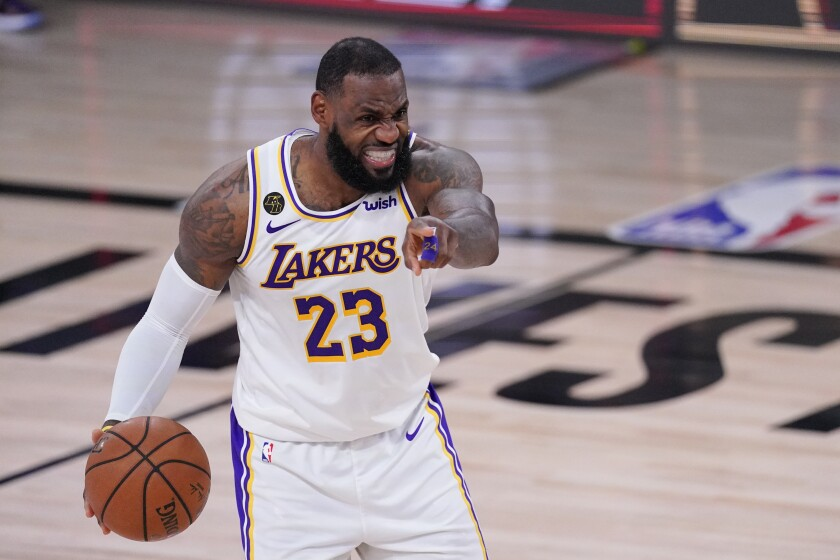 Lakers forward LeBron James directs the offense against the Rockets during Game 5 on Sept. 12, 2020.