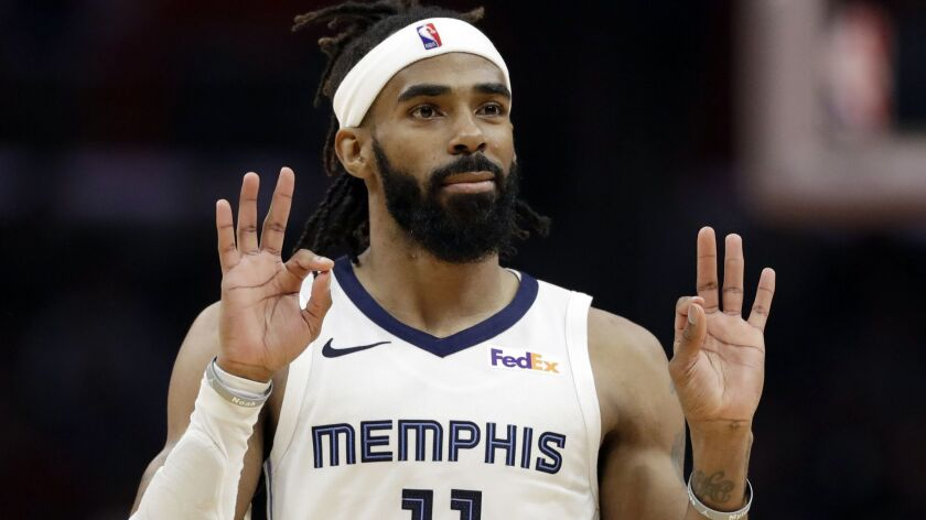 Grizzlies point guard Mike Conley reacts after making a three-point shot against the Clippers during the second half Friday.