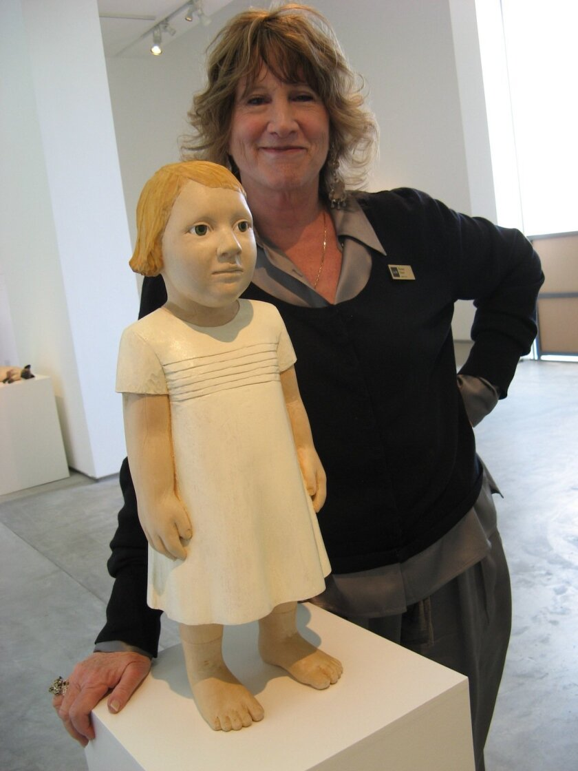 Lux director Reesey Shaw poses with one of Claudette Schreuder's haunting figures. Lonnie Hewitt