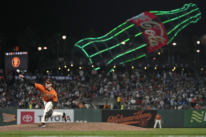 The Giants' Anthony DeSclafani pitches in his team's 3-2, 11-inning win over the Dodgers on Friday in San Francisco.
