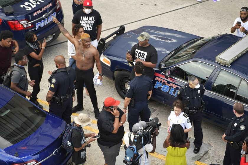 Atlanta Police Chief Erika Shields speaks with media as protesters gather, Friday, May 29, 2020, in Atlanta, in response to the death of George Floyd in police custody on Memorial Day in Minneapolis. (AP Photo/Mike Stewart)