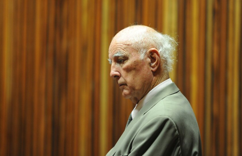 Retired tennis player Bob Hewitt sits in the dock in a court east of Johannesburg, South Afirca, Monday, March 23, 2015. Hewitt, a former Grand Slam doubles tennis champion, was convicted in a South African court of rape and sexual assault decades after the alleged assaults. (AP Photo)
