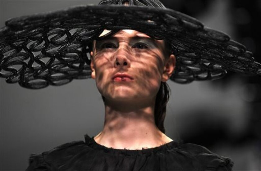 A model wears a design created by John Rocha at London Fashion Week Spring/Summer 2014 on Saturday Sept. 14, 2013 at Somerset House, London. (Photo by Richard Chambury/Invision/AP Images)