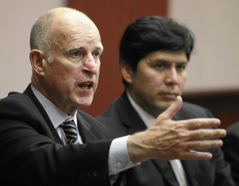 Gov. Jerry Brown, left, and Senate President Pro Tem Kevin de Leon campaign in Fountain Valley for Proposition 2.