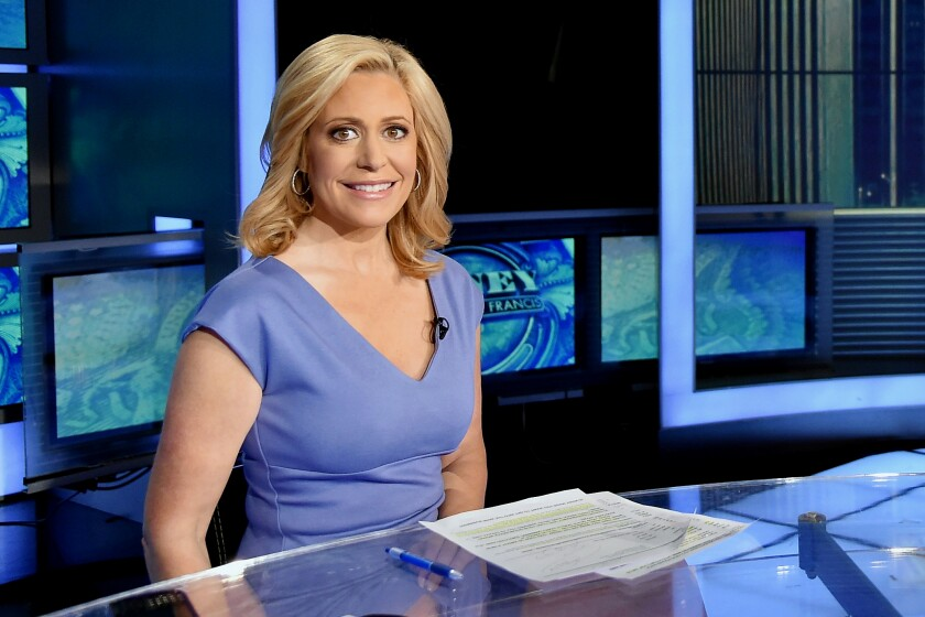 Melissa Francis sat an anchor's desk in Fox Business Network studio