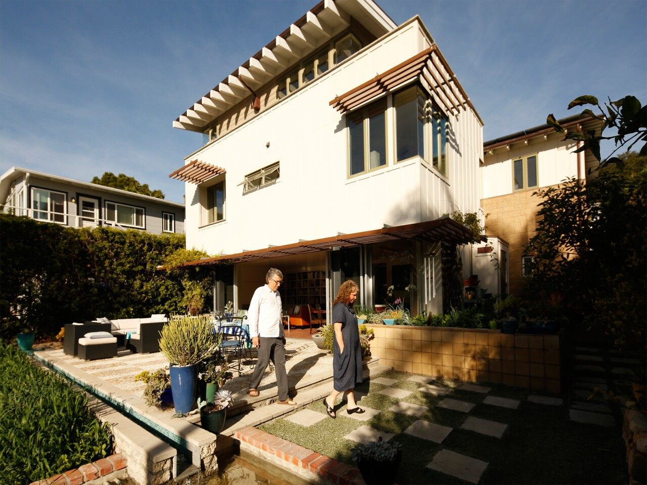 The backyard of the Santa Barbara home of architect Kevin Dumain and his wife Jill, which emphasizes indoor-outdoor California living.
