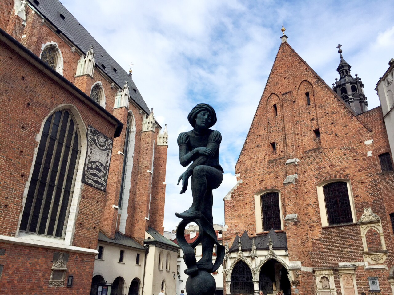 A statue of a medieval student between the churches of St. Mary and St. Barbara in Krakow's Medieval Centerpays tribute to the city's heritage as a university town.