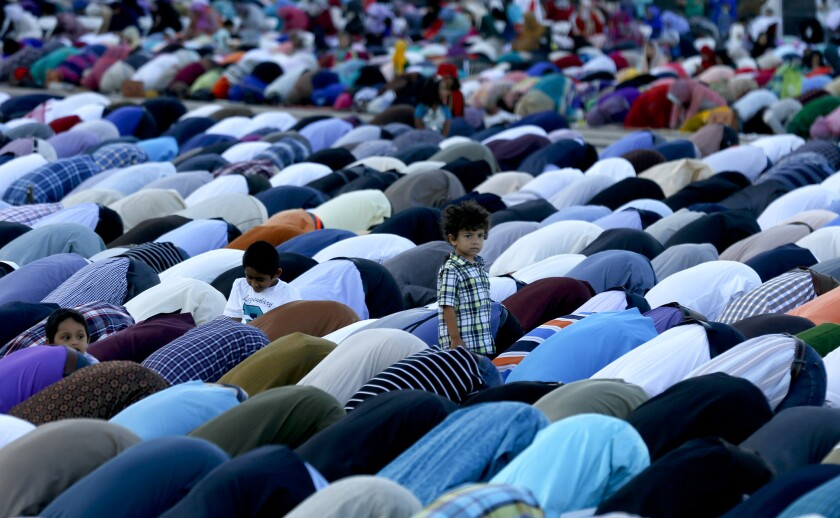 Orange County Muslims gather in prayer in the parking lot of Angel Stadium in Anaheim for Eid al-Adha to mark the end of the annual pilgrimage to Mecca known as Hajj on Sept. 23.
