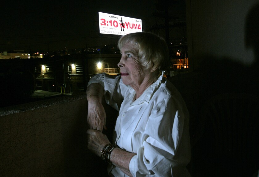 A Clear Channel digital billboard shines brightly into Dora Davis's Los Angeles apartment. The light is so bright it shines through onto her walls.