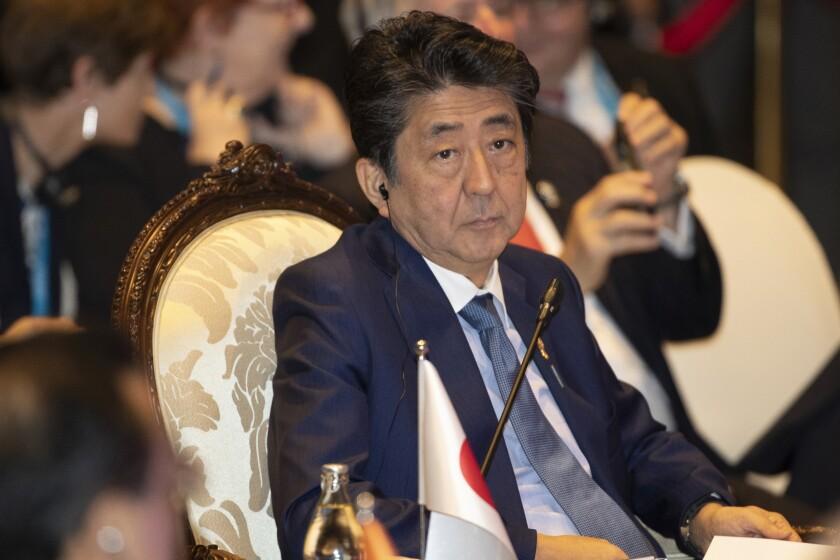 Japan's Prime Minister Shinzo Abe, attends East Asia summit in Nonthaburi, Thailand, Monday, Nov. 4, 2019. (AP Photo/Sakchai Lalit)