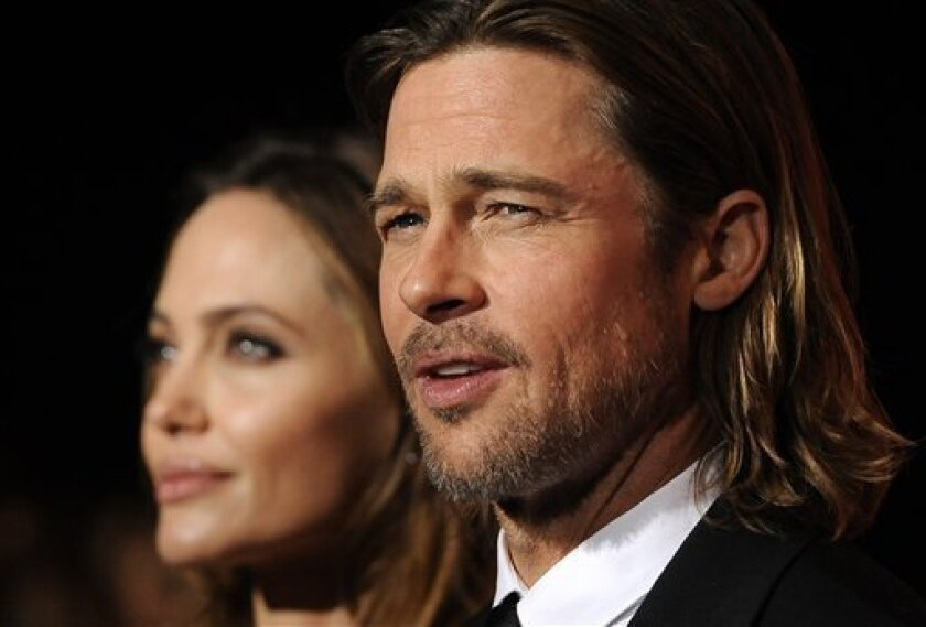 Brad Pitt, recipient of the Desert Palm Achievement Award Actor, poses with Angelina Jolie at the 2012 Palm Springs International Film Festival Awards Gala, Saturday, Jan. 7, 2012, in Palm Springs, Calif. (AP Photo/Chris Pizzello)