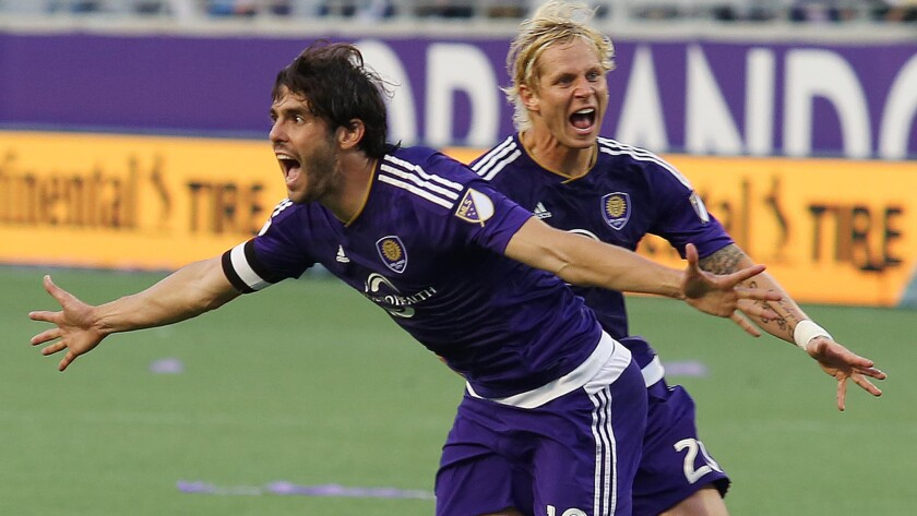 Orlando City's Kaka, front, celebrates with teammate Brek Shea after scoring the tying goal in stoppage time of a 1-1 draw with New York City on March 8.