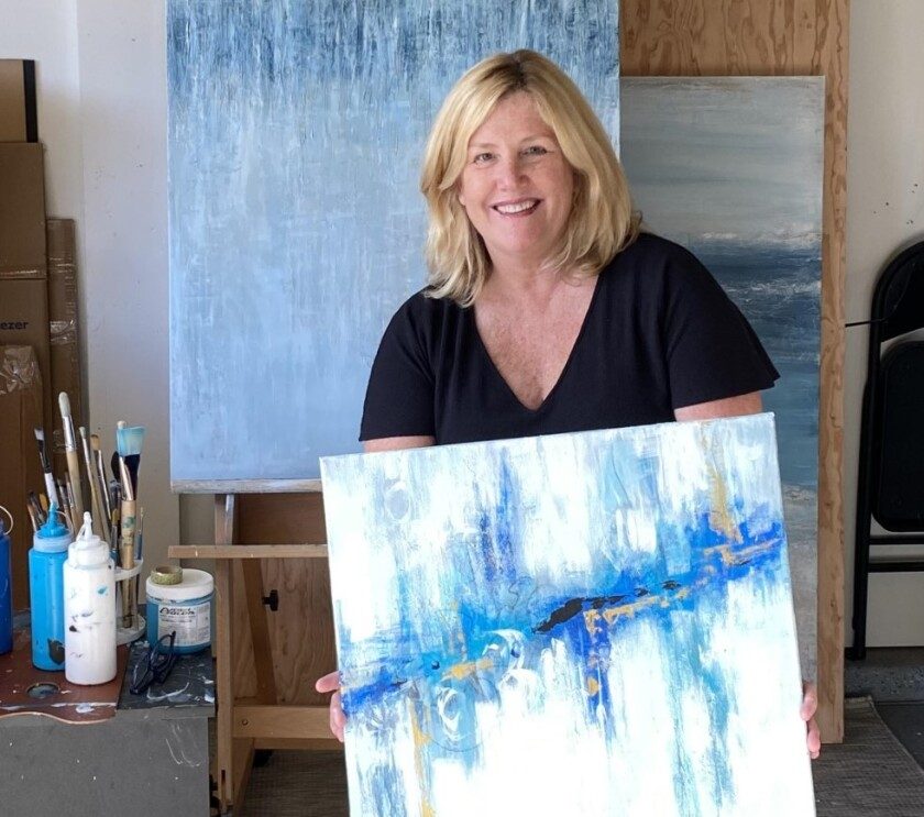 Carlsbad artist Denise Vakili was invited online to show the painting she holds .