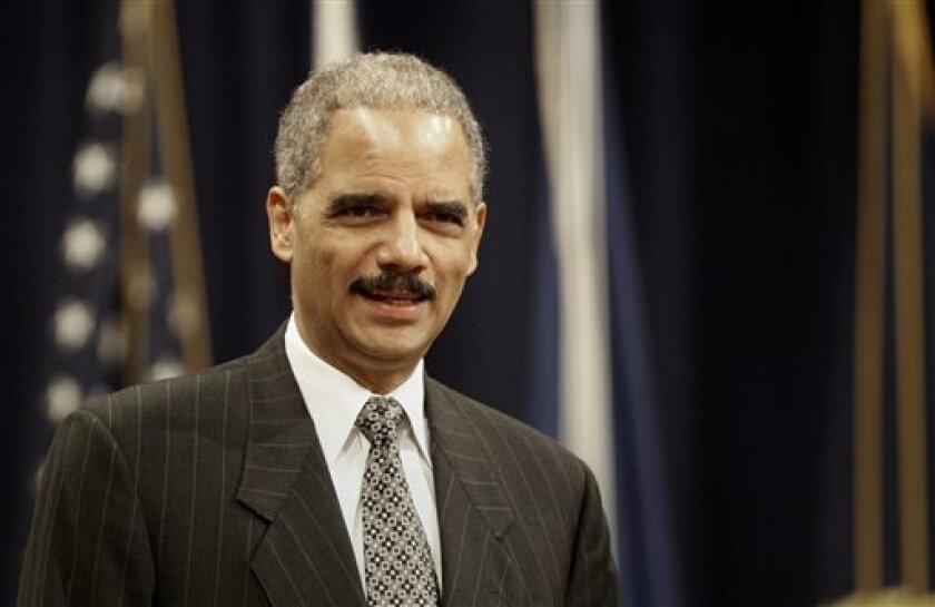 Attorney General Eric Holder makes remarks commemorating African American History Month, Wednesday, Feb. 18, 2009, during a ceremony at the Justice Department in Washington, Wednesday, Feb. 18, 2009. (AP Photo/Lawrence Jackson)