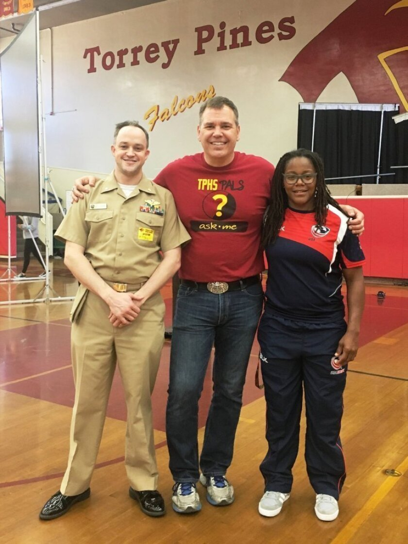 TPHS teacher Don Collins with Yellow Ribbon Week speakers Cmdr. Jeff Millegan and Phaidra Knight.