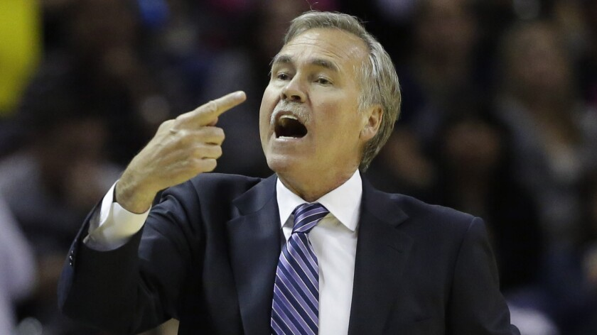 Lakers Coach Mike D'Antoni directs the Lakers during game against the Spurs in San Antonio.