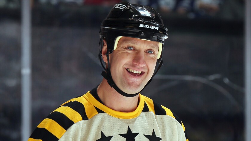 Former Kings defenseman and Hockey Hall of Fame inductee Rob Blake smiles while taking part in the annual legends hockey game in Toronto on Sunday.
