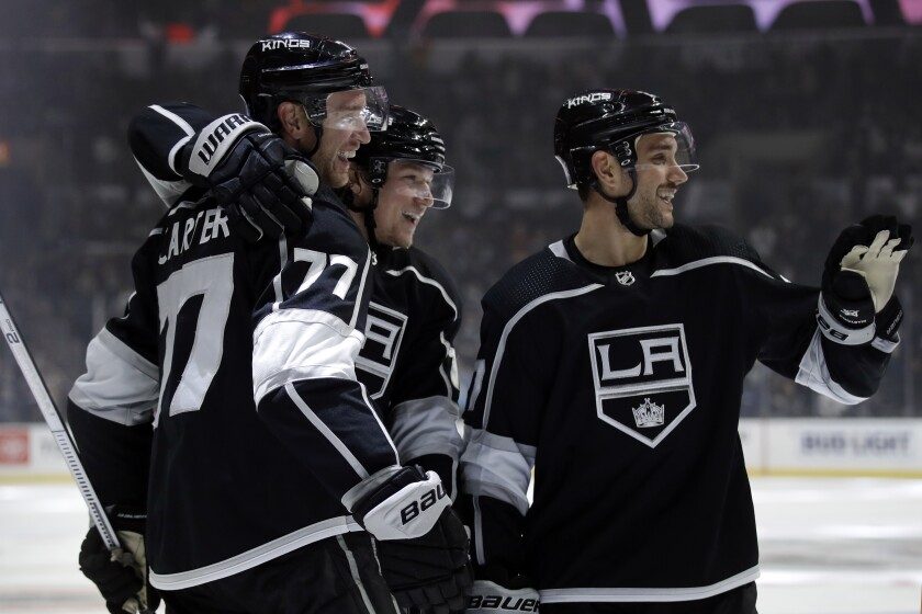 Los Angeles Kings' Jeff Carter (77) celebrates with teammates after scoring against the Minnesota Wild during the second period of an NHL hockey game Tuesday, Nov. 12, 2019, in Los Angeles. (AP Photo/Marcio Jose Sanchez)