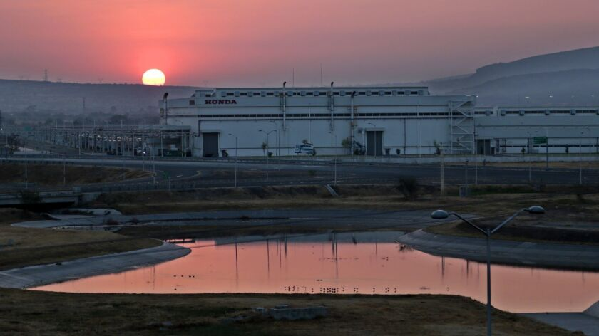 The sun rises over Honda automotive plants in Guanajuato. Hundreds of auto and parts factories have