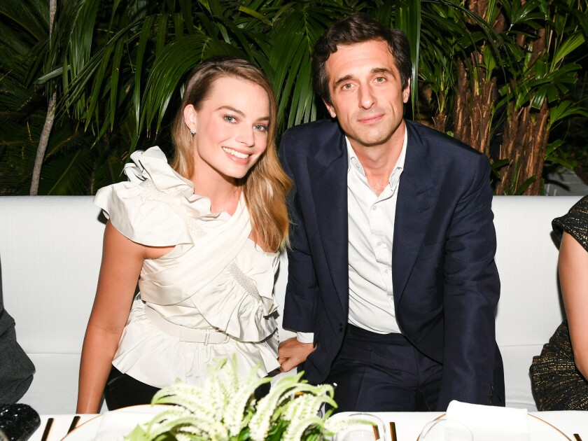 Actress Margot Robbie and perfumer Olivier Polge at the Chanel dinner at the Chateau Marmont in West Hollywood.