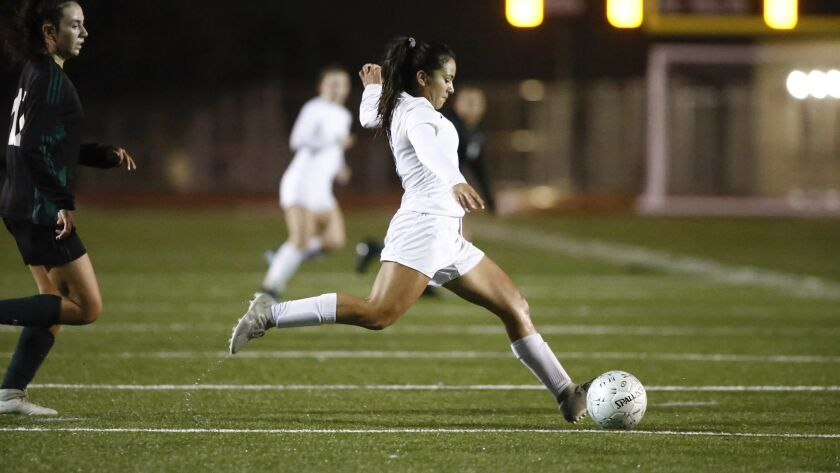 Valley Center's Angela Hernandez (5) passes the ball in the first half against Hilltop.