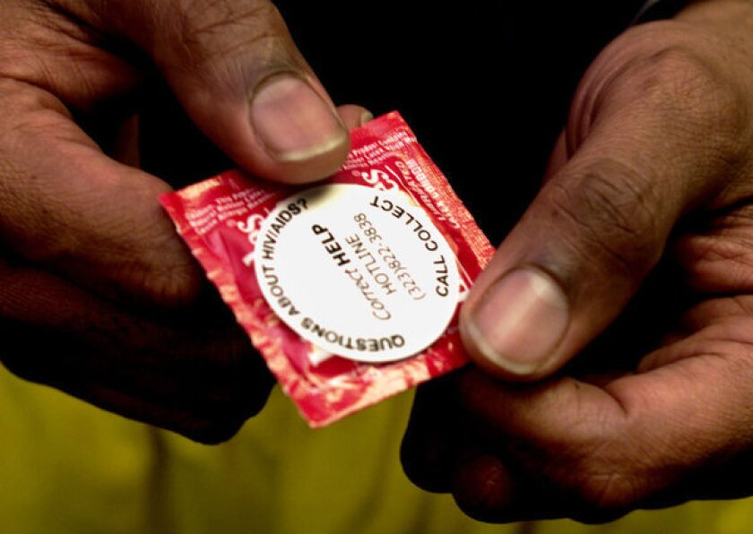 A Lifestyles condom with the number of an HIV/AIDS hotline.