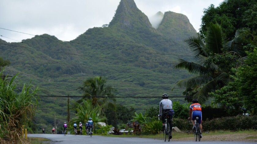 As they near the town of Waimanalo, bicyclists steer away from the coast to a rural, inland road.