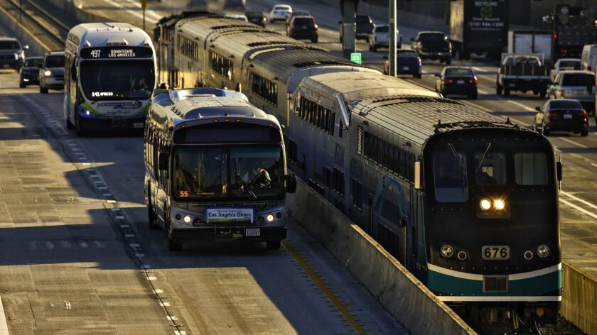 A Metrolink train travels along the 10 Freeway toward Union Station. State grants announced Thursday aim to improve rail and bus services.
