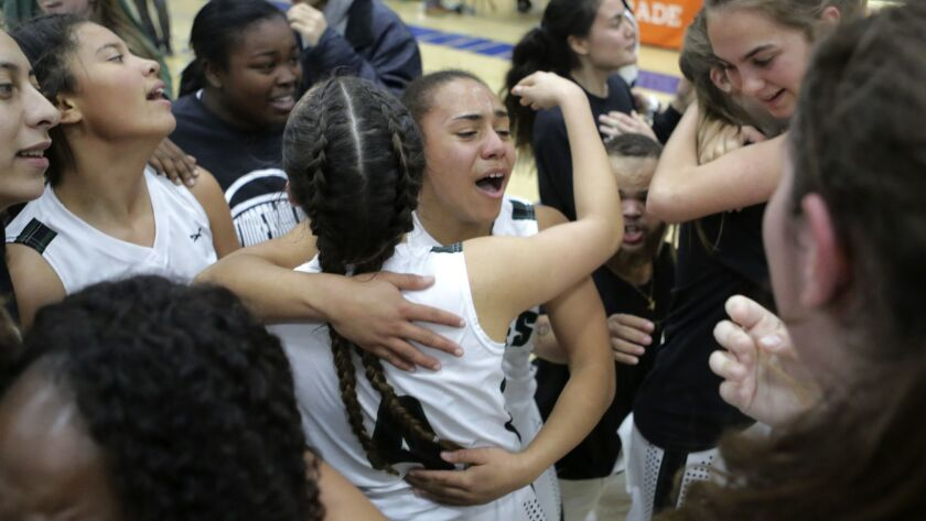 Mission Vista's Bethany Parker, center, celebrates with teammates after their victory over San Diegu
