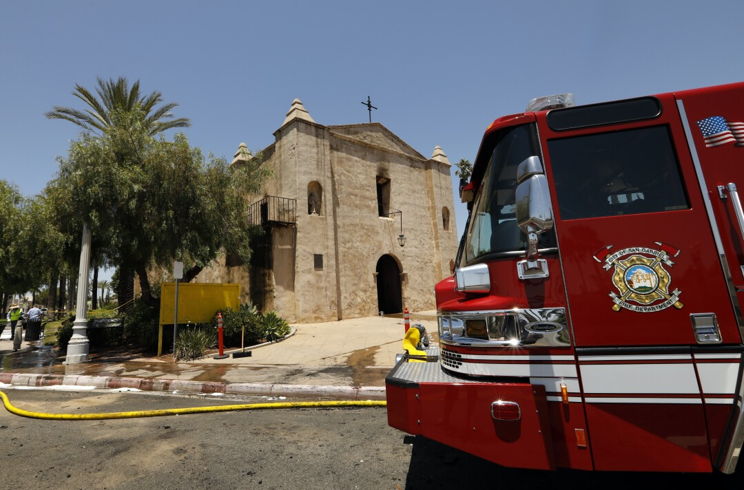 A fire truck sits outside the historic San Gabriel Mission on a sunny day
