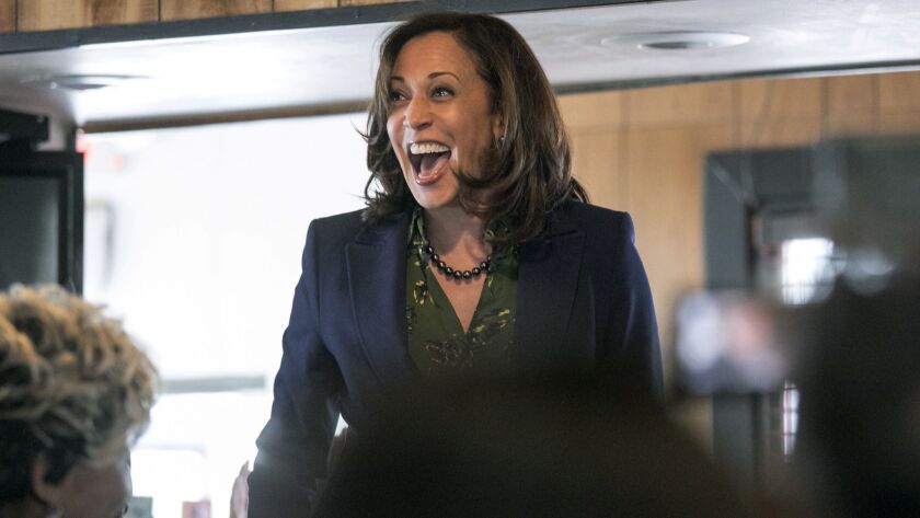 In this March 8, 2019 photo, Sen. Kamala Harris, meets with supporters at Big Mike's Soul Food, in