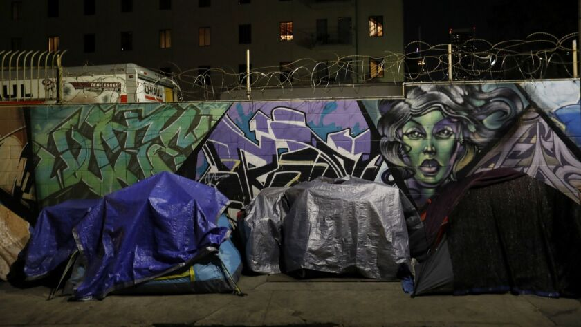 LOS ANGELES, CA FEBRUARY 2, 2018: Early morning before dawn tents line San Julian Street in the sk