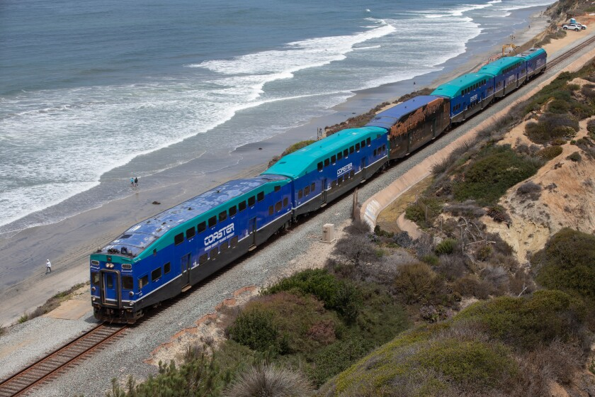 A Coaster train passes along the beach in Del Mar on Friday.