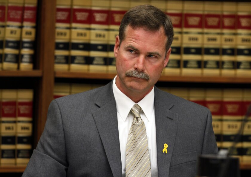 San Diego police Sgt. Kenneth Davis asked during a preliminary hearing in July that harassment and stalking charges against him be dismissed, but a Superior Court judge dismissed the request. His victim is a fellow police officer.