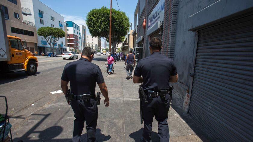LAPD officers patrol skid row downtown.