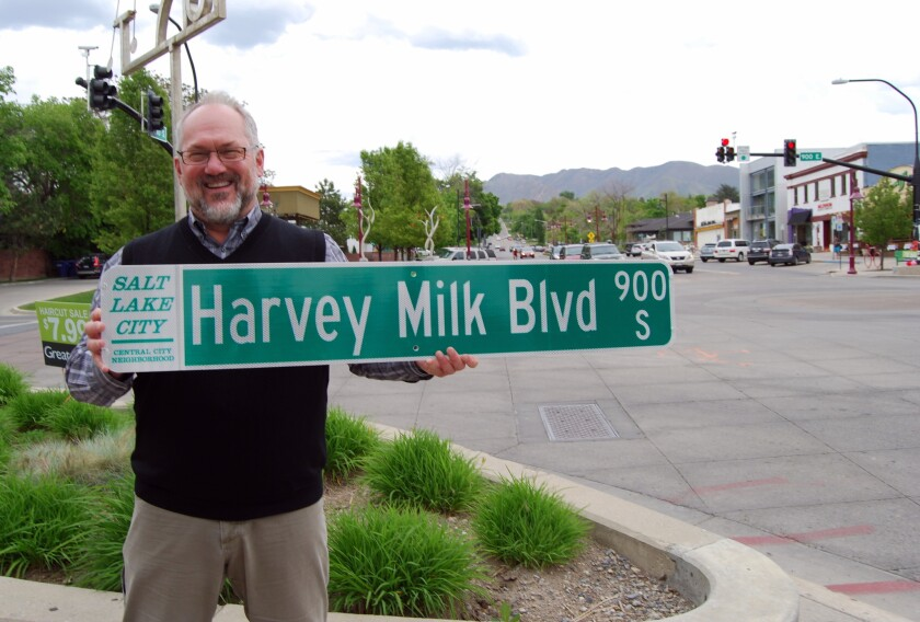 Openly gay Salt Lake City Councilman Stan Penfold with a new street sign.