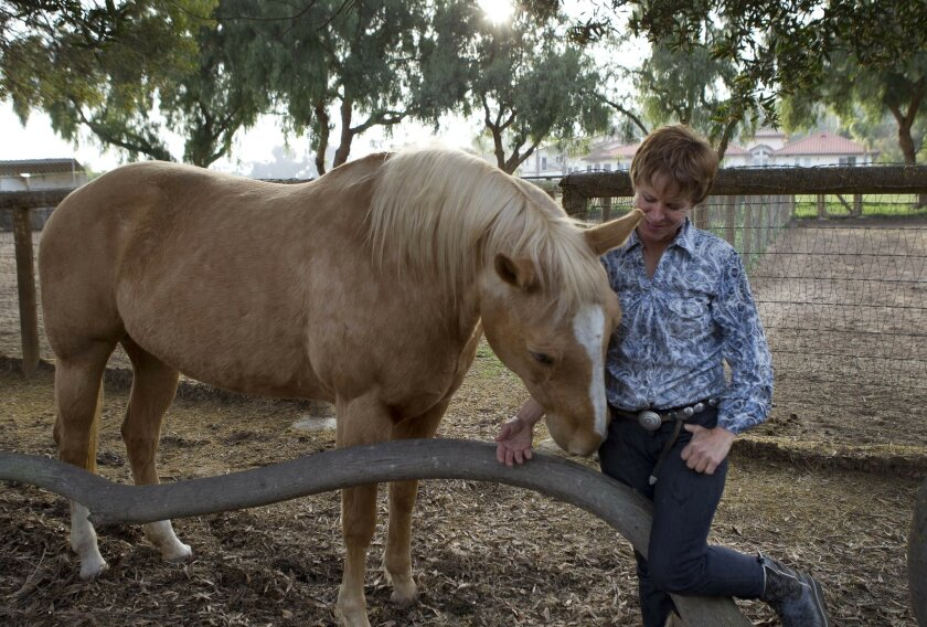 Julie Krone, the legendary jockey at a ranch in the Olivenhain area of Encinitas.  Krone is seen with a Mare named Miss Piggy.