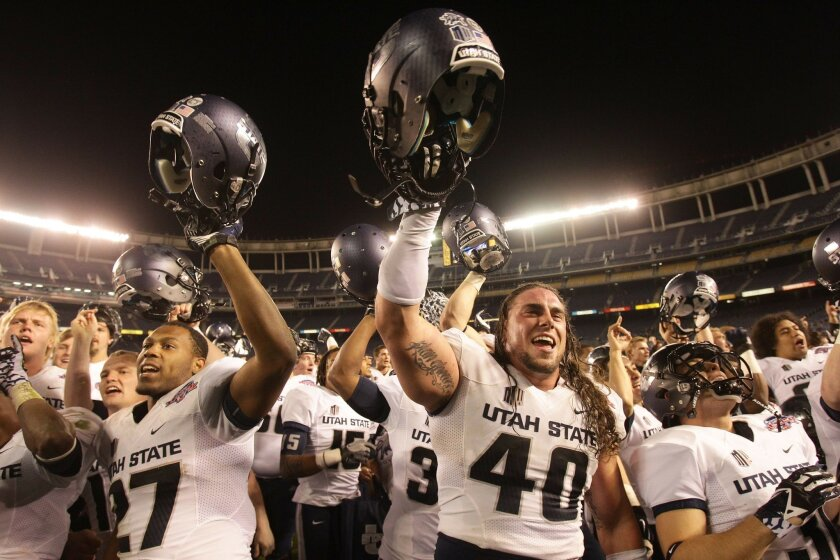 Utah State players celebrate after defeating Northern Illinois Thursday in the Poinsettia Bowl at Qualcomm Stadium.