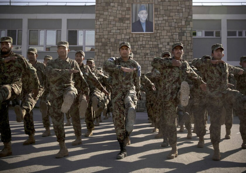 Afghan soldiers exercise at a training facility on the outskirts of Kabul last month.