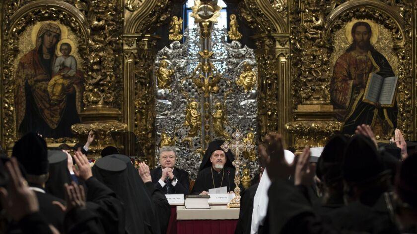 Ukrainian President Petro Poroshenko, center left, attends a closed-door synod of three Ukrainian Or