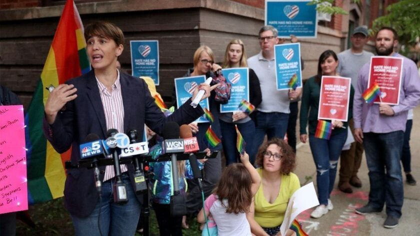 Ald. Deb Mell, 33rd, leads a small protest against Rev. Paul Kalchik of Resurrection Catholic Church in Chicago's Avondale neighborhood on Sept. 19, 2018. Kalchik recently burned a rainbow banner that had hung at Resurrection.