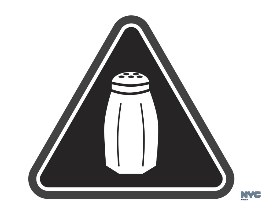 In this image provided by the New York City Health Department, a graphic warns of high salt content in foods at many fast-food and chain restaurants.