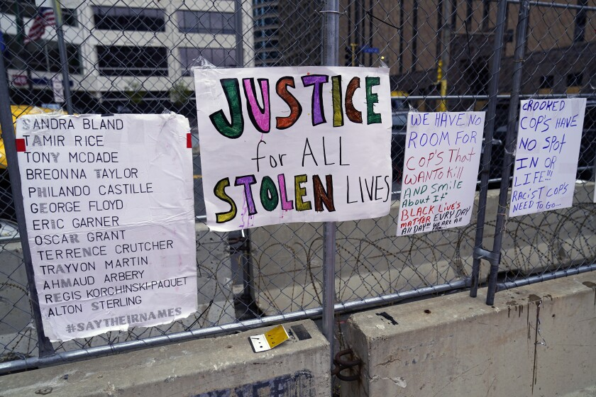 Signs on a fence at the Hennepin County Government Center on Monday