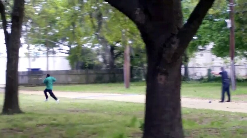 In this April 4, 2015, image from video, Walter Scott, left, runs as North Charleston Police Officer