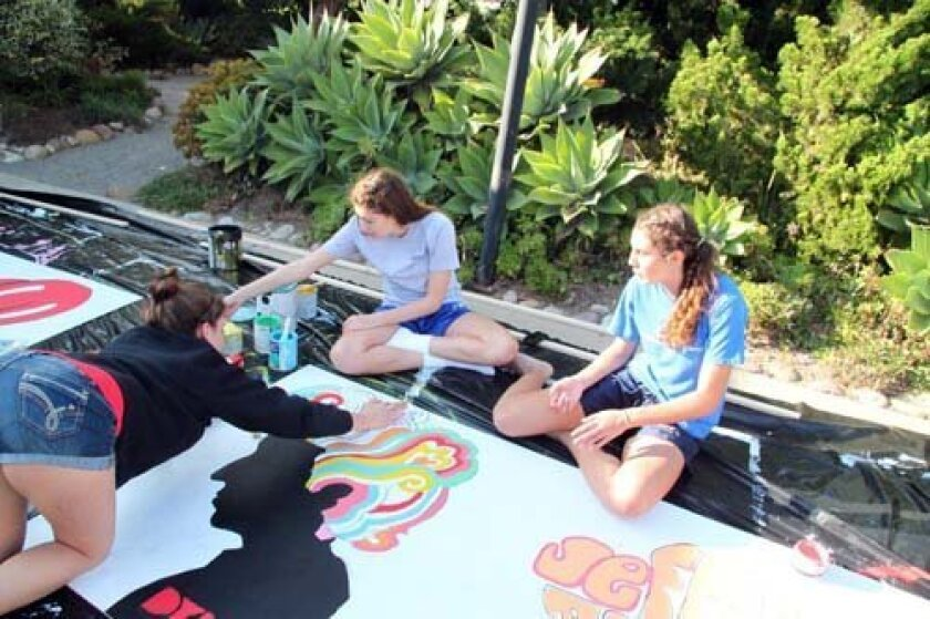 Kathryn Andrews, Zoe Kleinfeld, Karly Zlatic and Kelly Hancock work on the junior class float with its '60s theme. Photo: Giovannie Moujaes