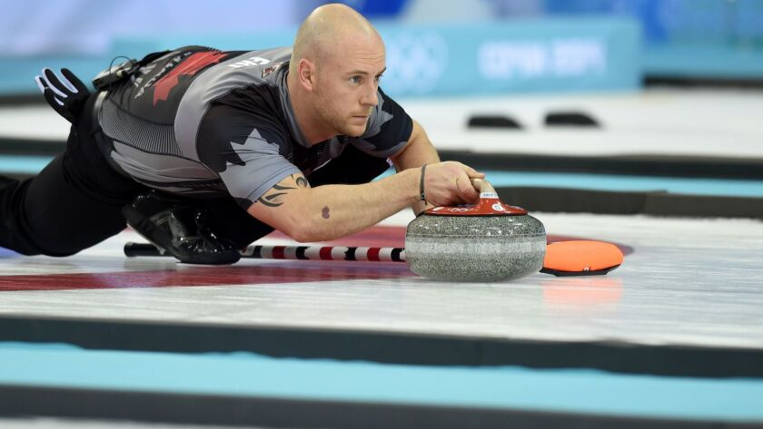 Canada's Ryan Fry throws the stone during the men's curling gold medal game against Britain during the Sochi Winter Olympics on Feb. 21, 2014.