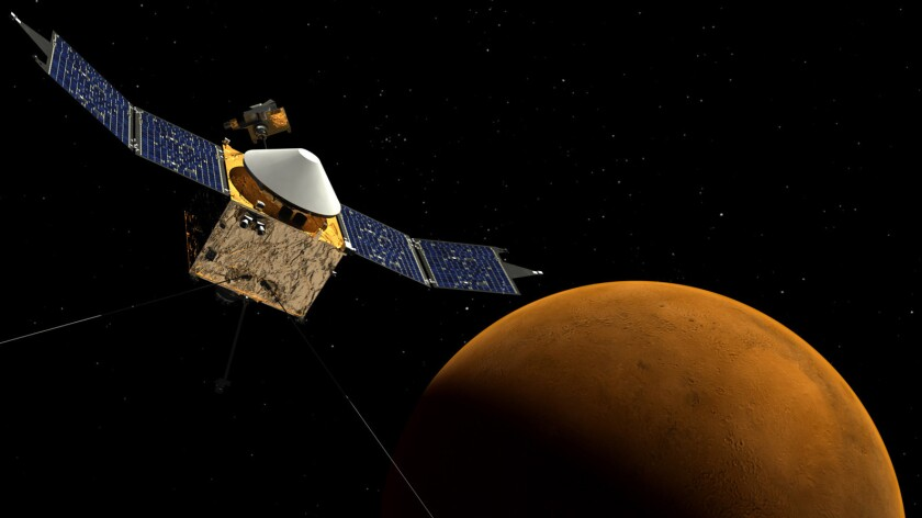 An artist's rendition shows NASA's Mars Atmosphere and Volatile Evolution spacecraft orbiting Mars. The spacecraft is four days from reaching the Red Planet, officials said Wednesday.