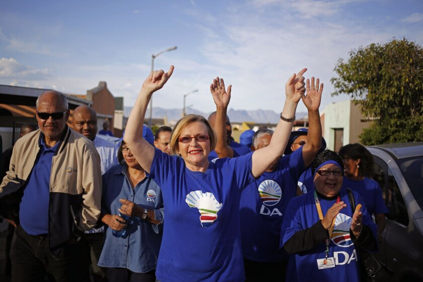 FILE-In this file photo taken on Tuesday, May 6, 2014, South African opposition leader Hellen Zille, centre, from the Democratic Alliance, participates un a party rally in Rocklands on the outskirts of Cape Town, South Africa. An article about fetal alcohol syndrome published earlier March in South