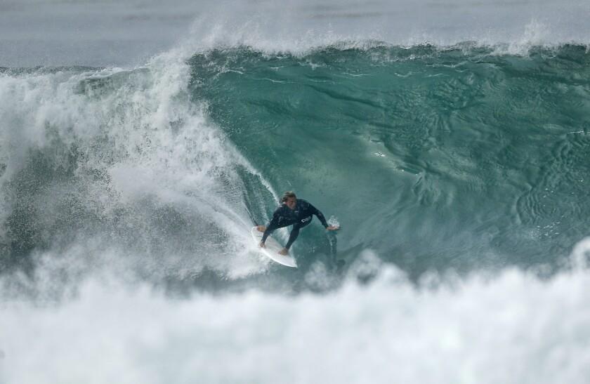 Chris Ward rides a wave in La Jolla